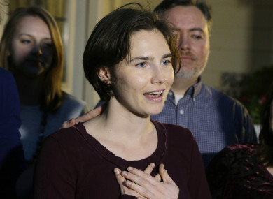 Amanda Knox talks to members of the media outside her mother's home, Friday, March 27, 2015, in Seattle.