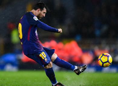 Barcelona's Lionel Messi scores against Real Sociedad