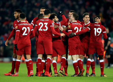 The Liverpool players celebrate.