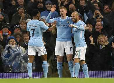 Manchester City's Raheem Sterling, Kevin De Bruyne and David Silva celebrate their second goal of the game.