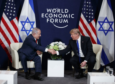 Trump shaking hands with Israeli Prime Minister Benjamin Netanyahu today in Davos.