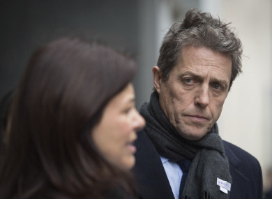 hugh grant settles phone hacking damages against uk newspapers