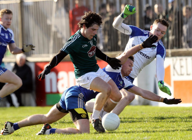 Chris Healy's shot is blocked by Fintan Kelly of Monaghan.