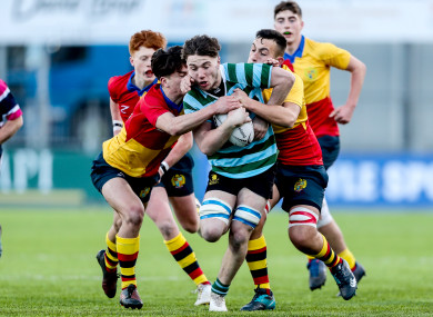 Ethan Baxter bursts through a couple of tackles during today's game at Donnybrook.