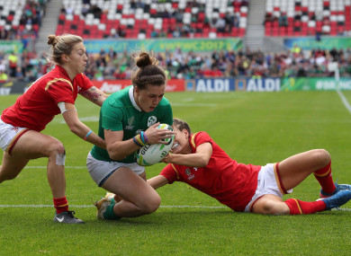 Katie Fitzhenry, pictured here scoring a try at the Women's World Cup last year, returns to the team.