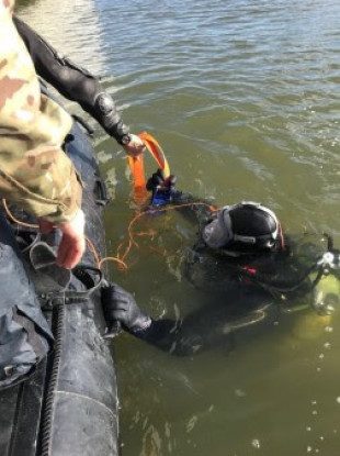 A Royal Navy diver assisting in the operation yesterday.