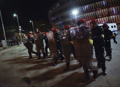 Police in riot gear outside the stadium