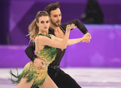 Gabriella Papadakis (Front) and Guillaume Cizeron of France compete during the ice dance short dance of figure skating at the 2018 PyeongChang Winter Olympic Games.