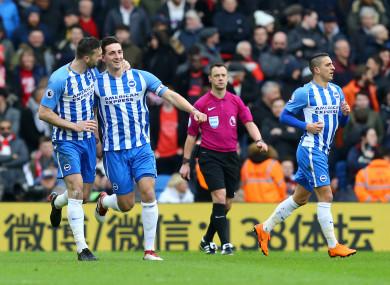 Shane Duffy (left) celebrates with Brighton goalscorer Lewis Dunk.