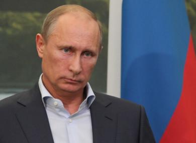 Russian President Vladimir Putin looking despondent.