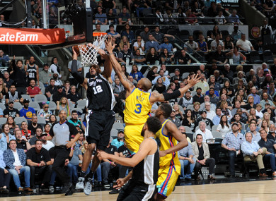 LaMarcus Aldridge dunks on an injury-ravaged Warriors side.