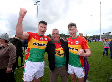 Carlow's John Murphy celebrates with Uncle Arthur and Mark Rennick after defeating Wexford in last year's Leinster championship.