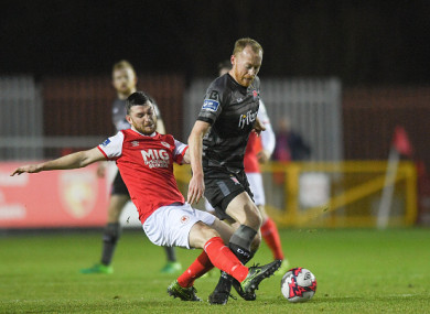 Dundalk midfielder Chris Shields is tackled by Ryan Brennan of St Pat's.
