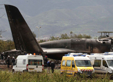 FIrefighters work at the scene after the plane went down near an airbase.