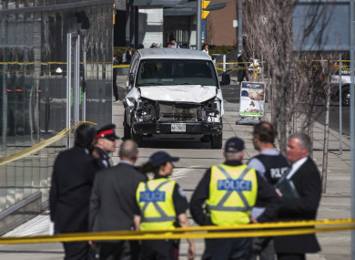 Police at the scene in Toronto after a van mounted a path, crashing into a number of pedestrians