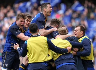 Leinster celebrate Leavy's try.
