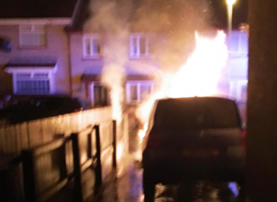The councillor's car in flames last night.