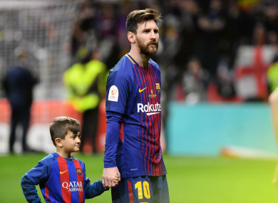 Lionel Messi accompanies his son after the Spanish King's Cup final match between FC Barcelona and Sevilla.