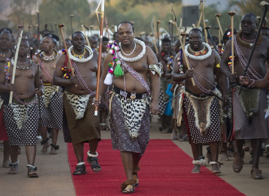 King Mswati III (C) attends a traditional ceremony, Umhlanga Festival at Ludzidzini Royal Village in Lobamba, Swaziland.