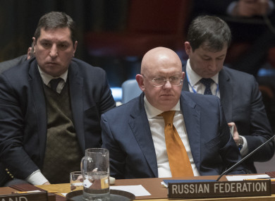 Russian Ambassador to the United Nations Vassily Nebenzia listens as British Ambassador to the United Nations Karen Pierce speaks during a Security Council meeting on the situation between Britain and Russia.