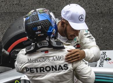 Hug it out: Hamilton and Bottas celebrate.