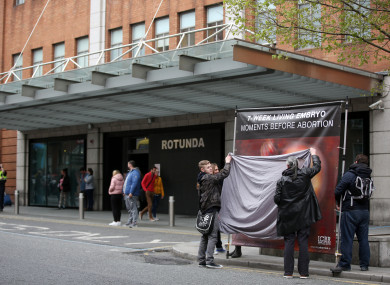 People block the ICBR posters outside the Rotunda Hospital