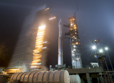 In this photo released by NASA, the mobile service tower at SLC-3 is rolled back to reveal the United Launch Alliance (ULA) Atlas-V rocket with NASA's InSight spacecraft onboard.