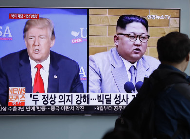 In this May 11, 2018, file photo, a man watches a TV screen showing file footage of U.S. President Donald Trump, left, and North Korean leader Kim Jong Un.