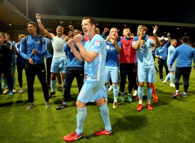 Coventry City's Michael Doyle celebrates with team-mates after the game.