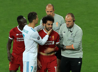 Real Madrid's Cristiano Ronaldo consoles Liverpool's Mohamed Salah as he leaves the pitch injured.
