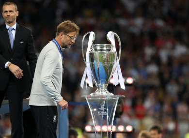Liverpool manager Jurgen Klopp walks dejected past the trophy after the UEFA Champions League Final.