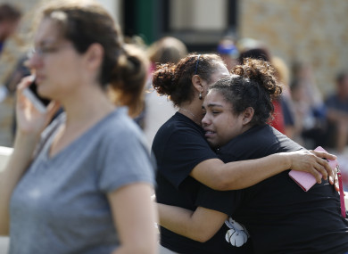 Santa Fe High School junior Guadalupe Sanchez, 16, cries in the arms of her mother, Elida Sanchez, after reuniting with her at a meeting point at a nearby Alamo Gym fitness centre following a shooting at Santa Fe High School in Santa Fe, Texas.