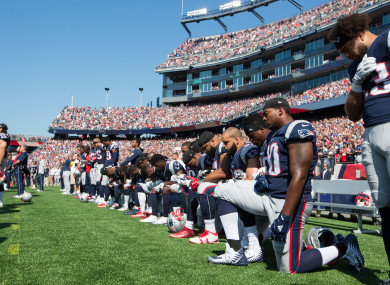 New England Patriots players take a knee before playing the Houston Texans last season.