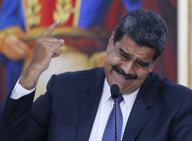 President Nicolas Maduro speaks during a meeting with international observers.