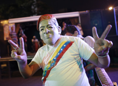 A supporter of the Venezuelan president celebrates victory.
