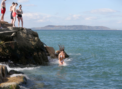 People jump into the water at the 40 Foot in Dublin.