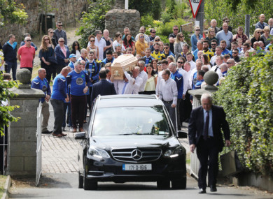 Pictured are friends, family and gym mates in the funeral procession for innocent shooting victim Bobby Messett.
