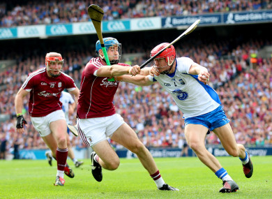 Galway's Conor Cooney and Waterford's Tadhg de Búrca.