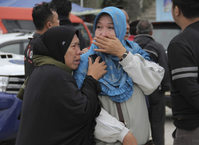 Relatives grieve after learning that their families members are among the passengers of the ferry which sank
