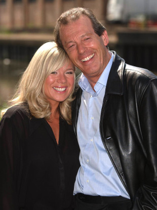 Leslie Grantham with actress Letitia Dean in 2003.