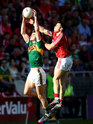 Kerry's Sean O'Shea in action against Cork's Stephen Cronin.