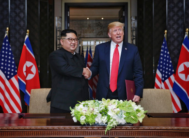 Top leader of the Democratic People's Republic of Korea (DPRK) Kim Jong Un (L) shakes hands with US President Donald Trump