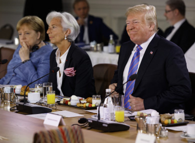Trump next to Angela Merkel and Christine Lagarde at the summit today.