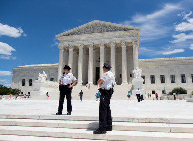 US Supreme Court police officers stand outside the Supreme Court in Washington DC