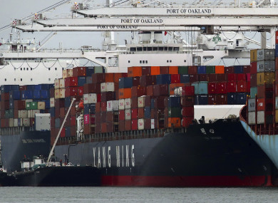 The Yang Ming shipping line container ship Ym Utmost is unloaded at the Port of Oakland on Monday.