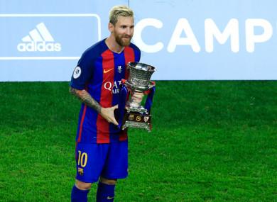 Lionel Messi holds the Supercopa de España in 2016.