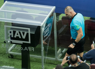 Referee Nestor Pitana walks to the VAR Monitor during the World Cup final.