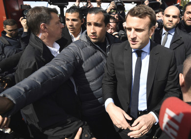French centrist presidential election candidate Emmanuel Macron, flanked by his bodyguard, Alexandre Benalla.