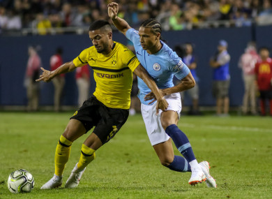 Manchester City midfielder Leroy Sane (19) battles Borussia Dortmund defender Jeremy Toljan.