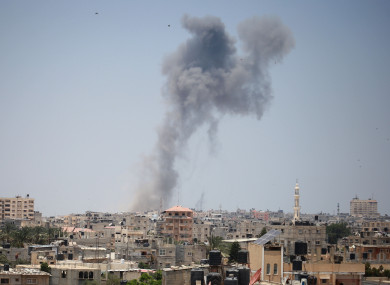 An explosion is seen following Israeli strikes in the southern Gaza Strip city of Rafah, near the border with Egypt.